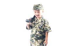 Rapaz pequeno com terno do soldado Fotos de Stock Royalty Free