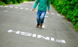 Rapaz pequeno corrido no passeio ao meta Fotografia de Stock Royalty Free