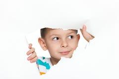 Rapaz pequeno curioso Imagens de Stock Royalty Free