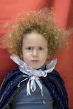 Rapaz pequeno Curly irritado Fotografia de Stock