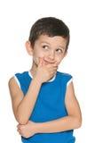 Rapaz pequeno deleitado Imagens de Stock