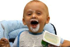 Rapaz pequeno durante a alimentação d Fotografia de Stock Royalty Free