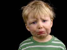 Rapaz pequeno muito triste Imagem de Stock Royalty Free
