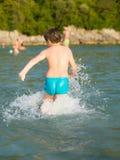 Rapaz pequeno na água Imagem de Stock Royalty Free