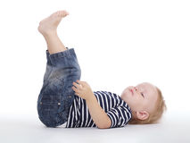 Rapaz pequeno no assoalho Imagens de Stock Royalty Free
