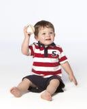 Rapaz pequeno no assoalho com basebol Imagem de Stock Royalty Free