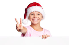 Rapaz pequeno no chapéu de Santa Imagens de Stock Royalty Free