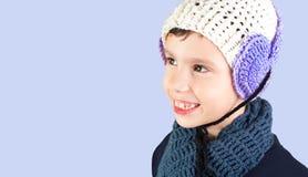 Rapaz pequeno no chapéu morno Fotografia de Stock Royalty Free