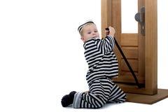 Rapaz pequeno no equipamento do ladrão Fotografia de Stock Royalty Free