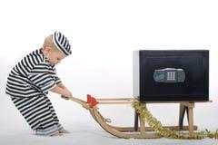 Rapaz pequeno no equipamento do ladrão Imagens de Stock