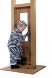 Rapaz pequeno no equipamento do ladrão Imagem de Stock
