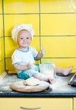 Rapaz pequeno no traje do cozinheiro Foto de Stock Royalty Free