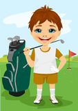 Rapaz pequeno novo com um clube de golfe Imagens de Stock Royalty Free