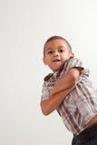 Rapaz pequeno novo em camisa e em calças de brim checkered Imagens de Stock Royalty Free