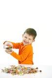 Rapaz pequeno que come doces Imagem de Stock Royalty Free