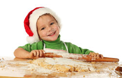 Rapaz pequeno que cozinha o bolo do Natal Foto de Stock Royalty Free