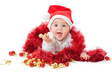 Rapaz pequeno que desgasta um chapéu de Santa Foto de Stock Royalty Free