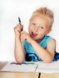 Rapaz pequeno que faz trabalhos de casa Fotografia de Stock