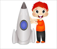 Rapaz pequeno que joga com seus brinquedos do foguete Foto de Stock Royalty Free