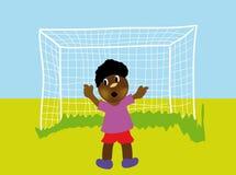 Rapaz pequeno que joga o futebol Imagem de Stock