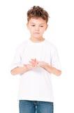 Rapaz pequeno que olha afastado Fotos de Stock Royalty Free