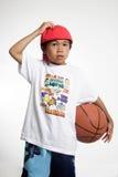 Rapaz pequeno que risca sua cabeça Foto de Stock Royalty Free