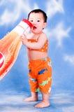 Rapaz pequeno sedento Imagem de Stock