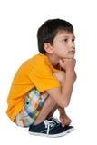 Rapaz pequeno triste pensativo Imagens de Stock