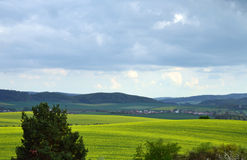 Field. With hills and clouds royalty free stock image