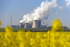 Rape field and power plant Stock Photography