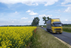 Rape field truck Royalty Free Stock Photo