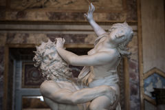 Rape of Proserpine  by Gian Lorenzo Bernini. Baroque marble sculptural group by Italian artist Gian Lorenzo Bernini, Rape of Proserpine in Galleria Borghese Royalty Free Stock Photography