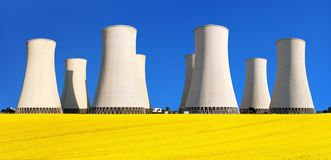 Rapesed field nuclear power plant cooling tower stock photo