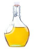 Rapeseed oil. Extra virgin rapeseed oil in a bottle isolated on white Royalty Free Stock Photo