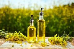 Rapeseed Oil Bottles Canola On Background Rape Field Stock Photo