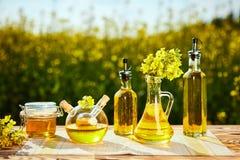 Rapeseed Oil Bottles Canola On Background Rape Field Stock Image