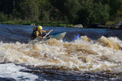 In the rapid. Young sportsman in the rapid stock image