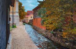 Rapid brook in the center of old European town Royalty Free Stock Image