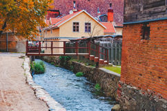 Rapid brook in the center of old European town Stock Image