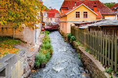 Rapid brook in medieval city, Europe Royalty Free Stock Photo
