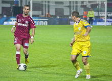 Rapid Bucharest Football Player Hitting the Ball Stock Images