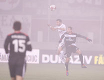 Rapid Bucharest - Gaz Metan Medias. Bawab and a Rapid Bucharest player   aerial battling  for the ball during the football match between Rapid Bucharest  and Gaz Royalty Free Stock Photo