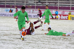 Rapid Bucharest - Unirea Urziceni. Unirea Urziceni's player running with the ball in the football match between Rapid Bucharest and Unirea Urziceni in Romanian Stock Photos