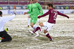 Rapid Bucharest - Unirea Urziceni. Rapid Bucharest's player kicking the ball in the football match between Rapid Bucharest and Unirea Urziceni in Romanian League Stock Photography