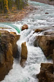 The rapid current of the falls. The rapid current. A falls in a narrow and deep canyon in the north of Canada stock image