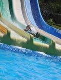 Rapid descent. Outdoor water park , man is driving down rapid descent Stock Image