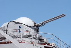 Rapid-firing gun. On a warship over blue sky Stock Photography