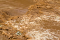 Rapid flow of brown water in the muddy river during rainy season Stock Photography