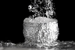 The rapid flow of water into the bowl. Royalty Free Stock Images