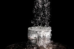 The rapid flow of water into the bowl. Royalty Free Stock Photo
